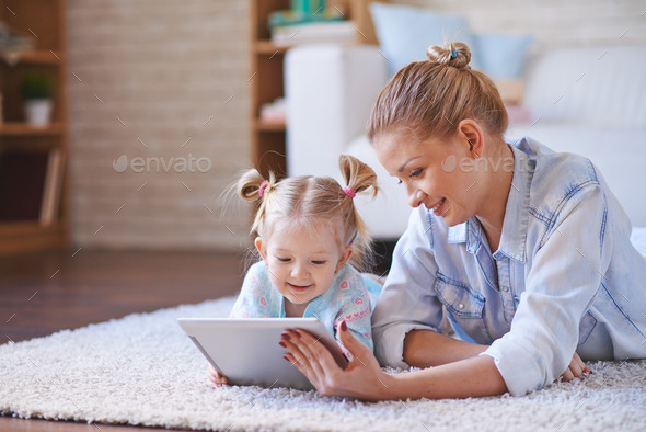 Watching cartoons in the net - Stock Photo - Images