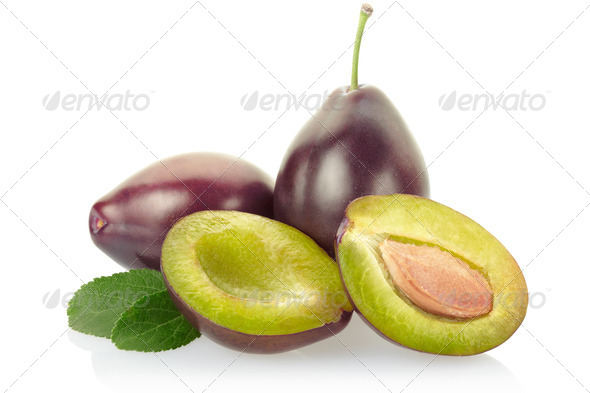 Plums with leaves - Stock Photo - Images