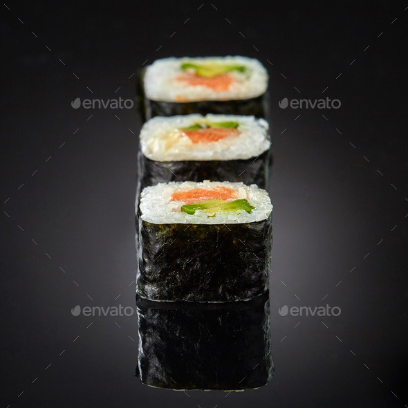 Sushi with salmon and avocado - Stock Photo - Images