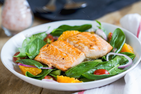 Salmon with orange and spinach salad - Stock Photo - Images