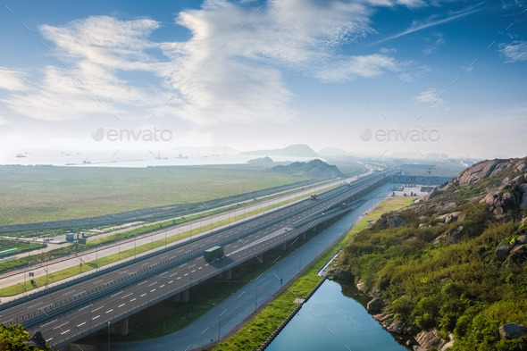 highway against a blue sky - Stock Photo - Images