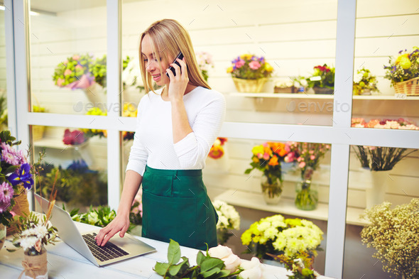 Florist consulting buyers - Stock Photo - Images