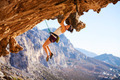 Young female rock climber on a face of cliff - PhotoDune Item for Sale