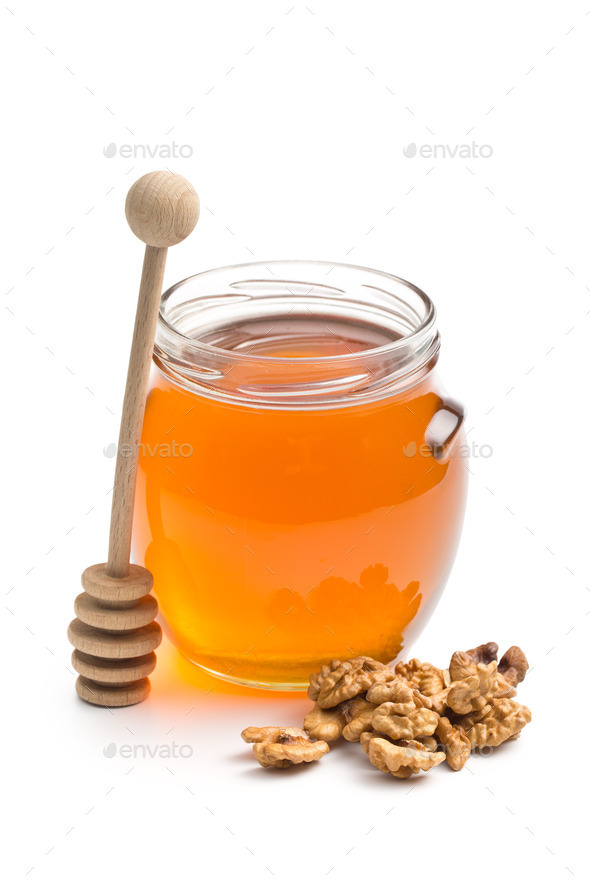 honey in a jar and walnuts - Stock Photo - Images