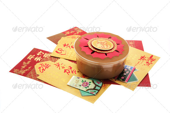 Chinese New Year Cake and Red Packets - Stock Photo - Images