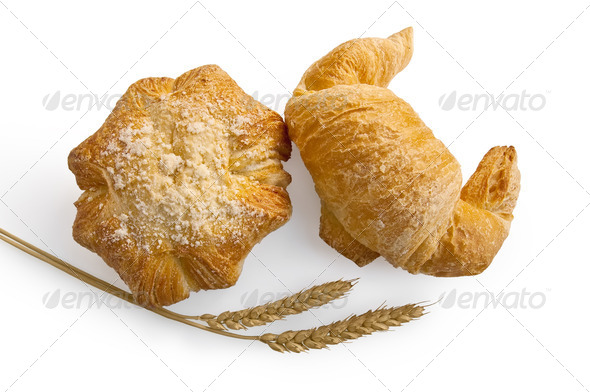Croissant and bread roll with stems of wheat - Stock Photo - Images