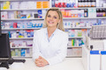 Pharmacist smiling at camera at the hospital pharmacy - PhotoDune Item for Sale