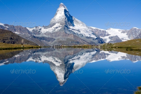 Tourists in front of the Matterhorn - Stock Photo - Images