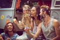 Hipsters blowing bubbles in camper van on a summers day - PhotoDune Item for Sale