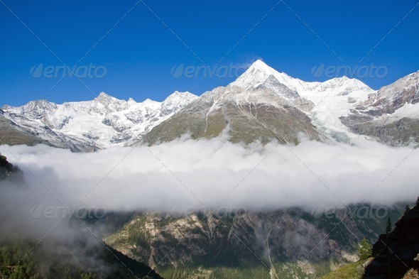 Clouds in the Zermatt valley - Stock Photo - Images