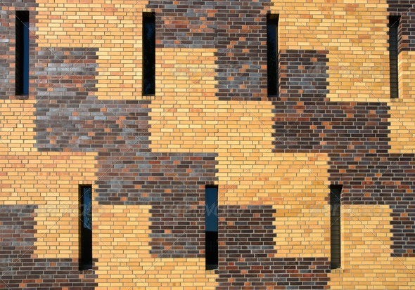 Brick wall with small windows - Stock Photo - Images