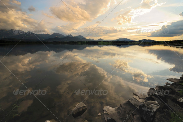 Sunset at an alpine lake - Stock Photo - Images