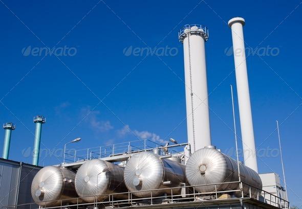 Tanks and smokestacks - Stock Photo - Images