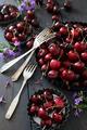 Fresh summer cherries and flowers in aluminum plates - PhotoDune Item for Sale