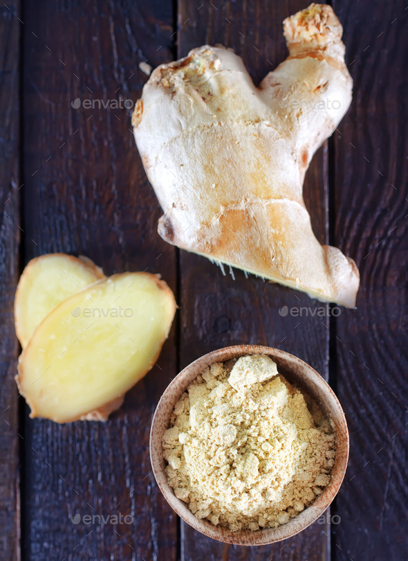 dry ginger in the wooden bowl and on a table - Stock Photo - Images