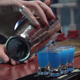 Bartender Pouring Drink Shots at the Bar - VideoHive Item for Sale