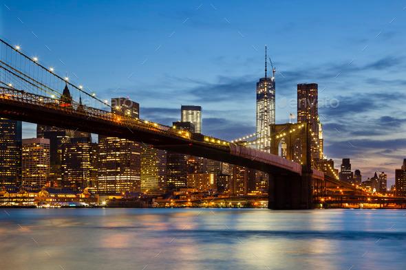 Brooklyn Bridge in New York At Night - Stock Photo - Images