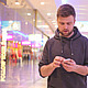 Young Man Walking and Looking at the Phone - VideoHive Item for Sale