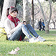 Girl Listening to Music in the Park - VideoHive Item for Sale