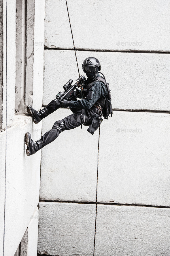 tactical rappeling - Stock Photo - Images