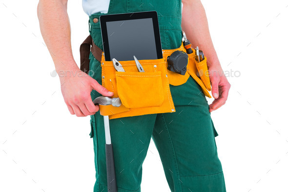 Construction worker wearing tools belt on white background - Stock Photo - Images