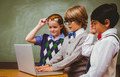 Little school kids using laptop in the classroom - PhotoDune Item for Sale