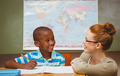 Portrait of teacher assisting little boy with homework in the classroom - PhotoDune Item for Sale