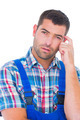 Portrait of confused manual worker scratching head on white background - PhotoDune Item for Sale