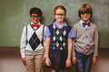 Portrait of smiling little school kids in classroom - PhotoDune Item for Sale