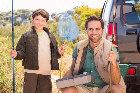 Father and son on a fishing trip on a sunny day - Stock Photo - Images
