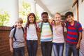 Portrait of smiling little school kids in school corridor - PhotoDune Item for Sale