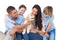 Happy family of four playing with dog over white background - PhotoDune Item for Sale