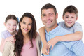 Portrait of happy parents giving piggyback ride to children against white background