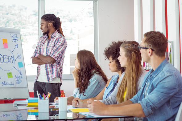 Students looking at white board at the college - Stock Photo - Images