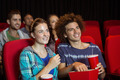 Young couple watching a film at the cinema - PhotoDune Item for Sale