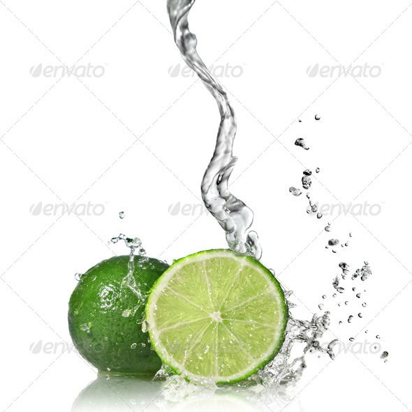Water splash on lime isolated on white - Stock Photo - Images