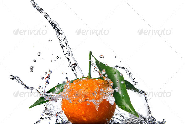 Tangerine with green leaves and water splash isolated on white - Stock Photo - Images