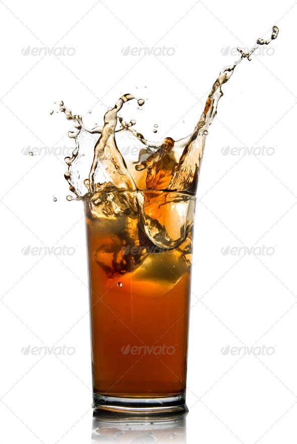 Beautiful splash of cola in glass isolated on white - Stock Photo - Images