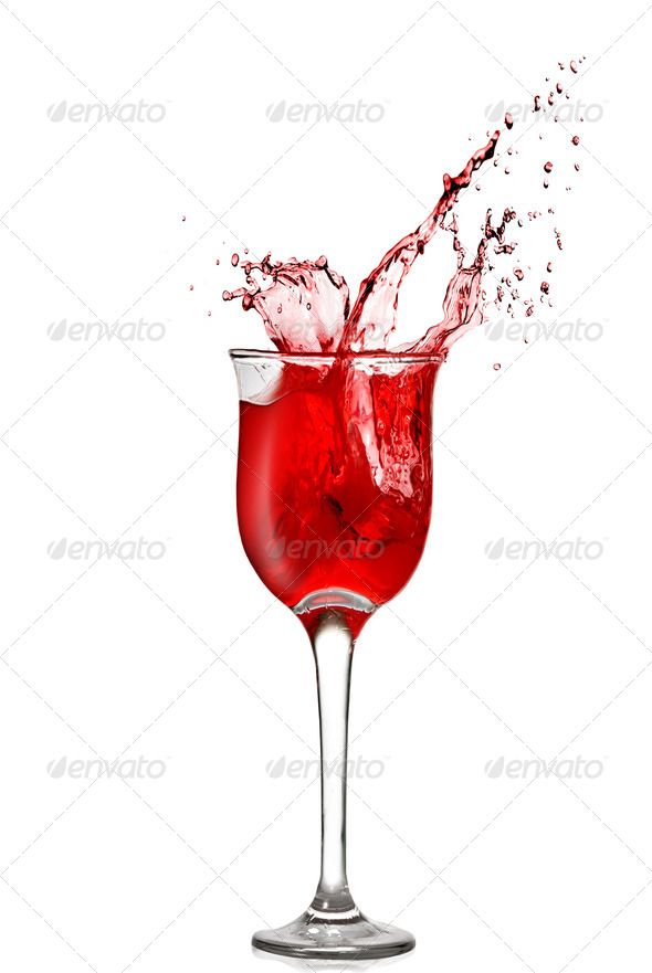 splash of red wine in goblet isolated on white - Stock Photo - Images