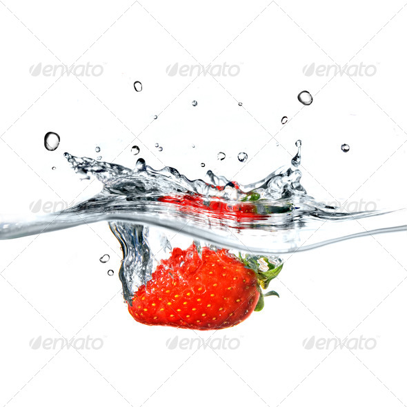 Fresh strawberry dropped into blue water with splash isolated on - Stock Photo - Images