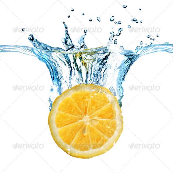 Fresh lemon dropped into water with splash isolated on white - Stock Photo - Images
