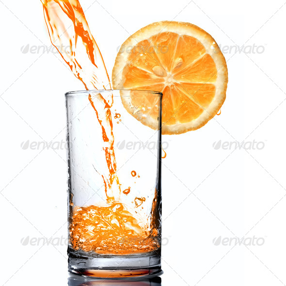 orange juice pouring into goblet with orange slice - Stock Photo - Images