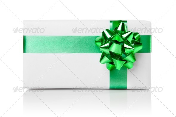 Holiday gift with green ribbon isolated on white - Stock Photo - Images