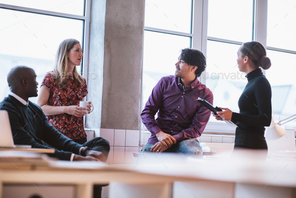 Team young professionals having casual discussion - Stock Photo - Images