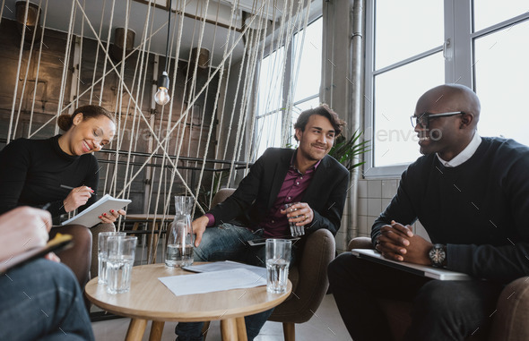 Executives having a meeting indoors - Stock Photo - Images
