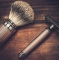 Safety razor and shaving brush on a wooden background - PhotoDune Item for Sale