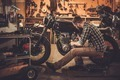 Mechanic building vintage style cafe-racer motorcycle  in custom garage - PhotoDune Item for Sale