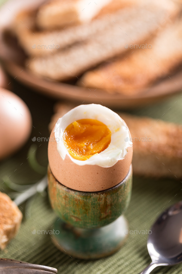 Boiled egg in eggcup - Stock Photo - Images
