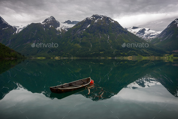 An old boat and some mountains - Stock Photo - Images