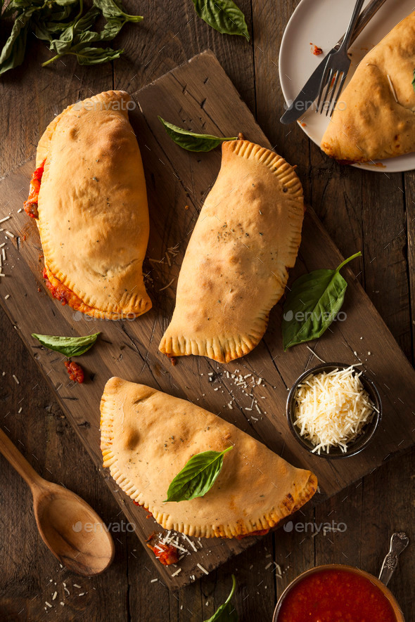 Homemade Italian Meat and Cheese Calzones - Stock Photo - Images